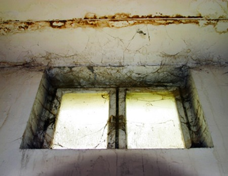Old window in a dirty in the deserted house